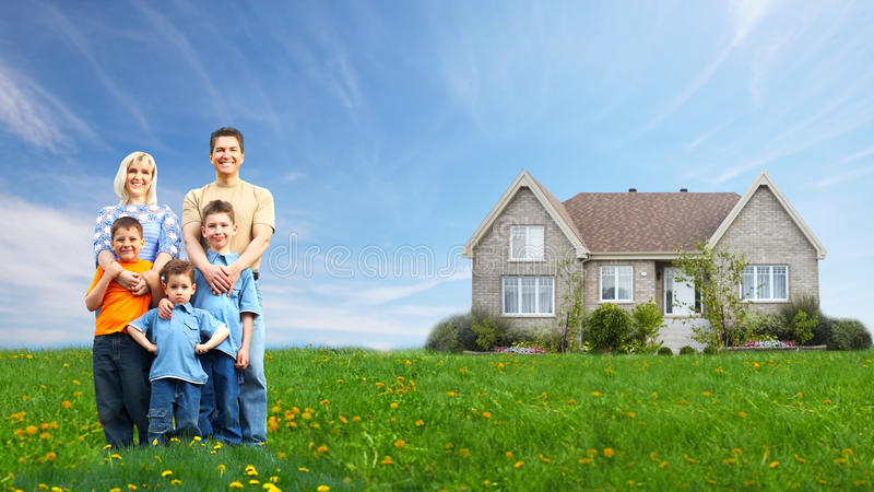 Happy family near new house. stock images