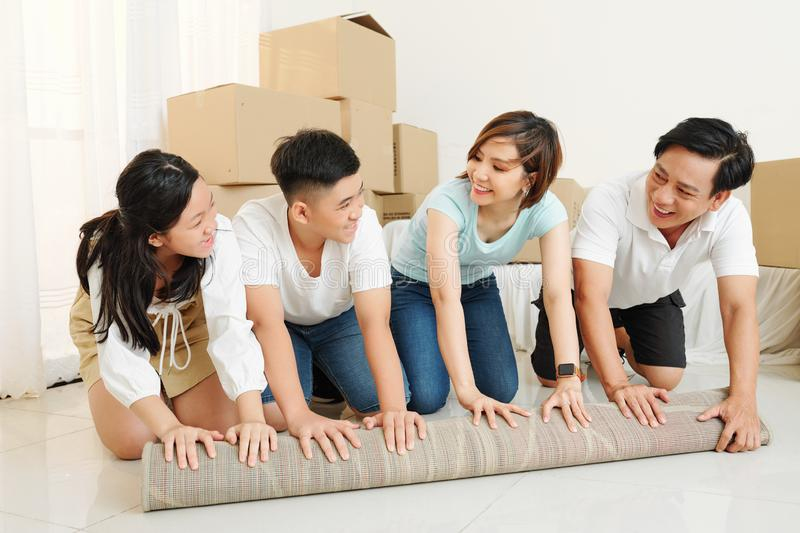 Happy family in new apartment royalty free stock photography