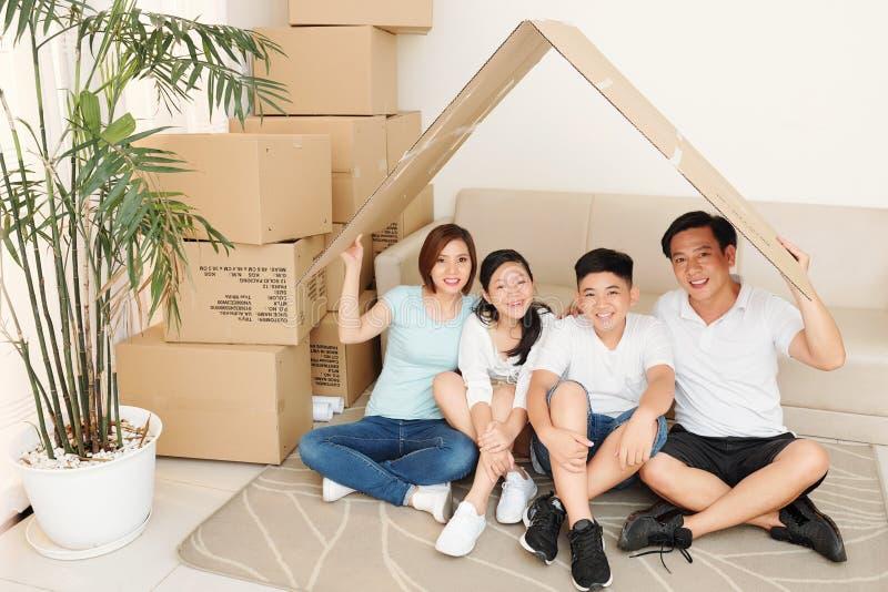 Happy family in new house royalty free stock photo