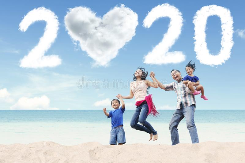 Happy family with number 2020 on beach stock photography