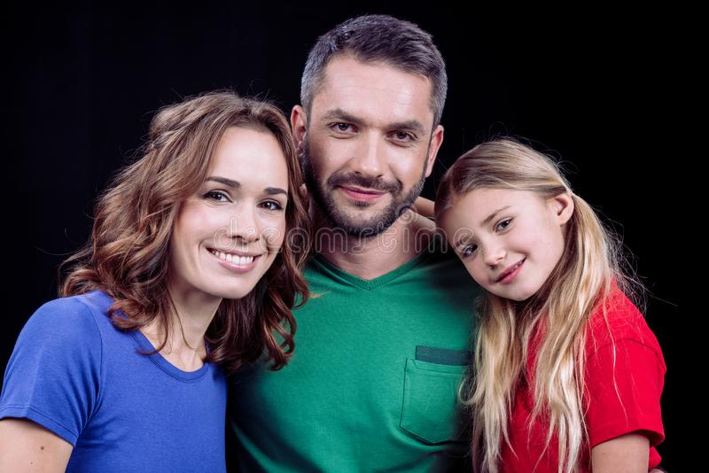 Portrait of happy family with one child looking at camera stock images