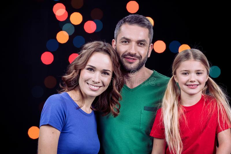 Portrait of happy family with one child looking at camera stock photography