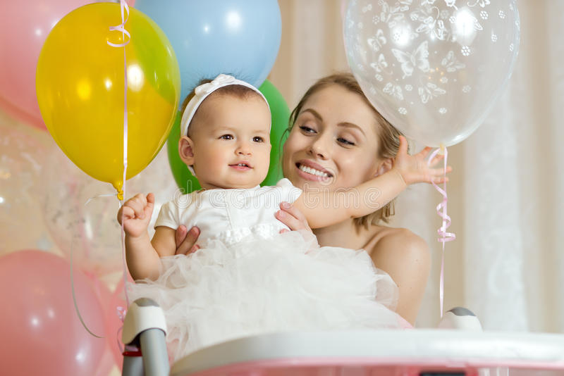 Happy family. One-year-old little girl with mammy, happy family, horizontal photo royalty free stock photo