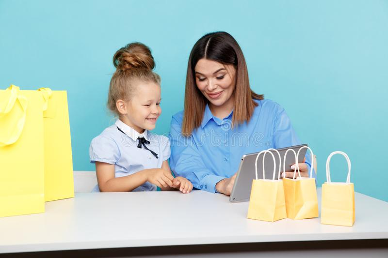 Happy family online shopping concept. Mom and child chooding things in internet isolated. royalty free stock image