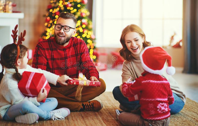 Happy family   open presents on Christmas morning royalty free stock photo