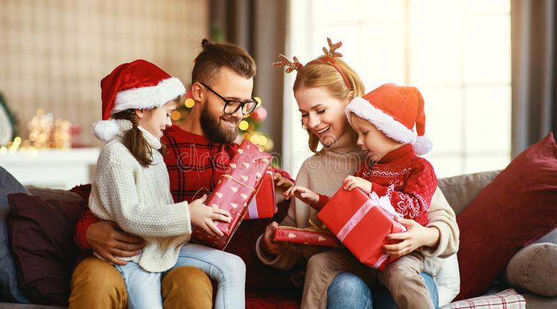 Happy family   open presents on Christmas morning royalty free stock images