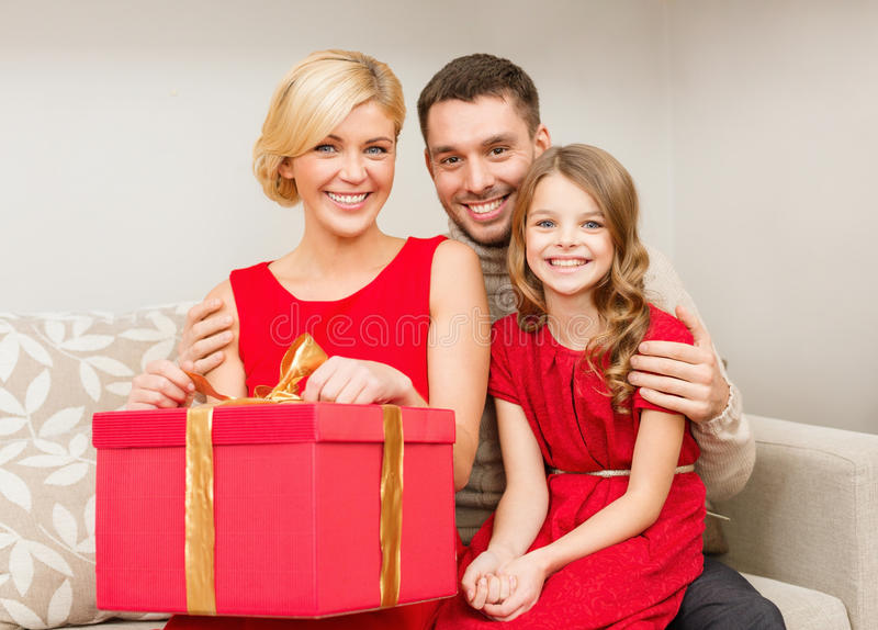 Download Happy Family Opening Gift Box Stock Photo - Image: 35225600