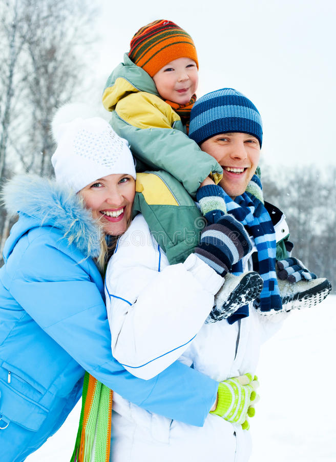 Happy family outdoor. Happy young family spending time outdoor in winter park stock photography