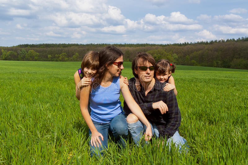 Download Happy Family Outdoors On Green Field Stock Photo - Image of horizontal, female: 22434002
