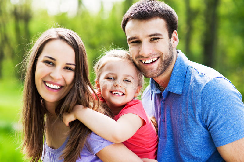Happy family outdoors. Happy family with little girl outdoors