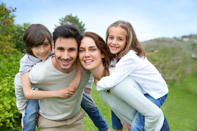 Happy family outdoors spending good time stock photo