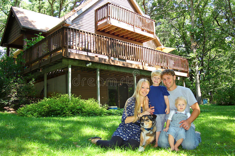 Happy Family Outside by Cabin stock images