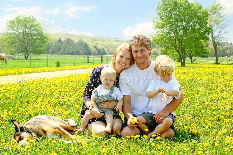 Happy Family Outside in Dandelions stock images
