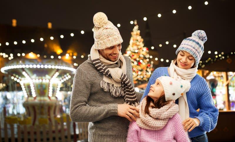 Happy family over christmas market in tallinn royalty free stock photo