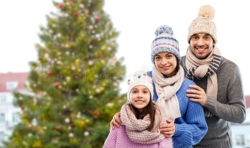 Happy family over christmas tree in tallinn royalty free stock photo