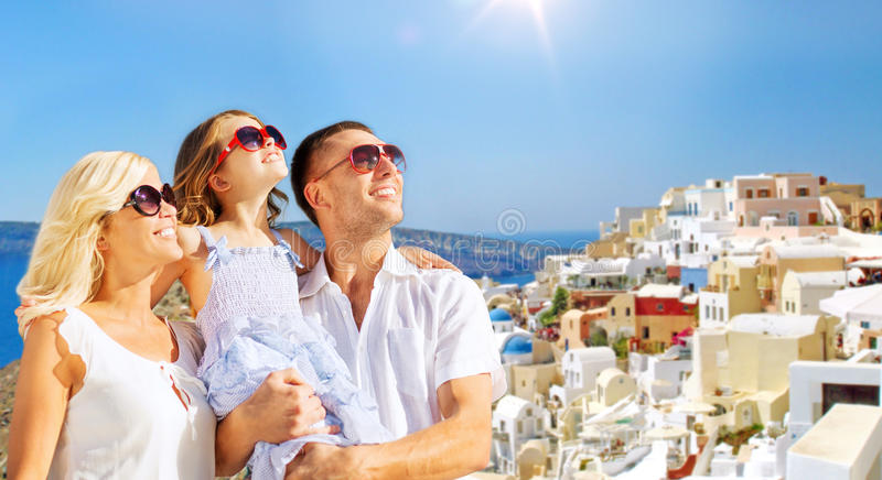 Happy family over santorini island background stock photography