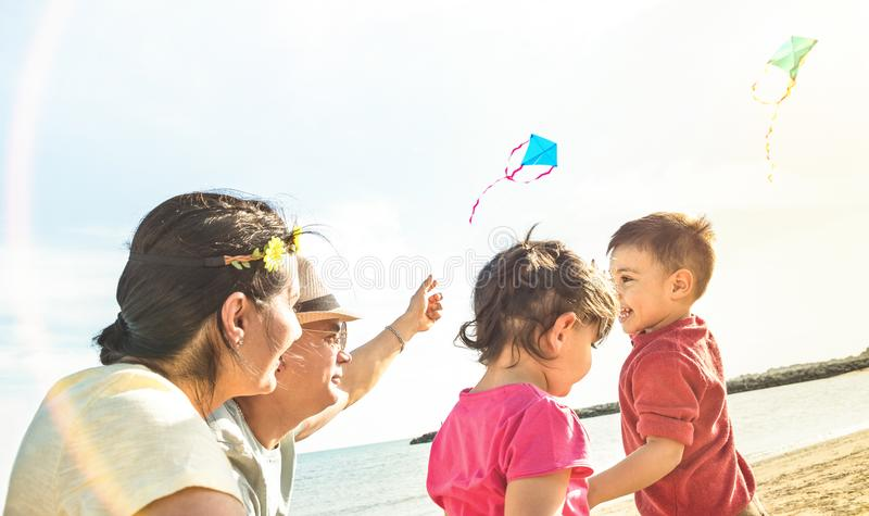 Happy family with parents and children playing together with kite stock photos