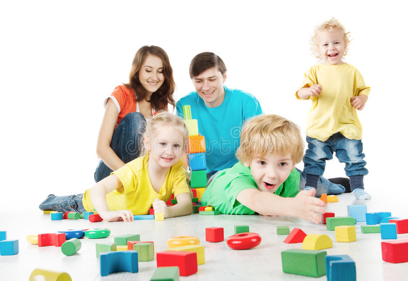 Happy family. Parents with three kids playing toys blocks stock photos