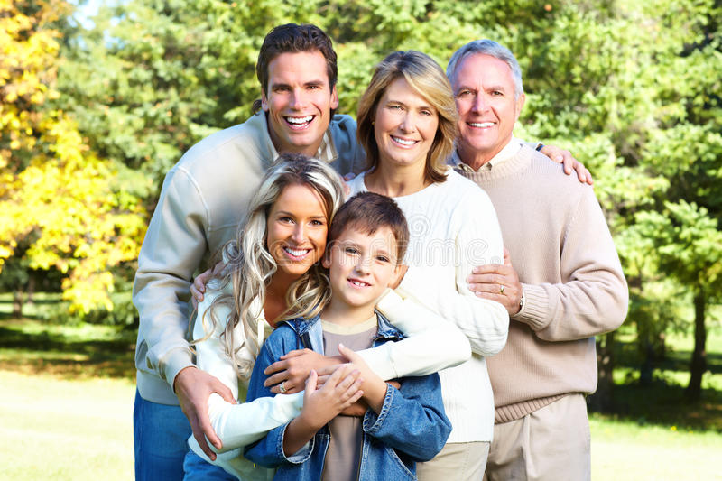 Happy family. In park. Grandfather, grandmother, father, mother and son royalty free stock image