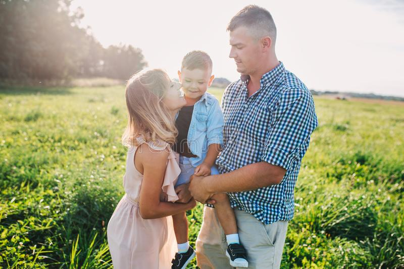 Happy family in park in sunny summer day royalty free stock photos