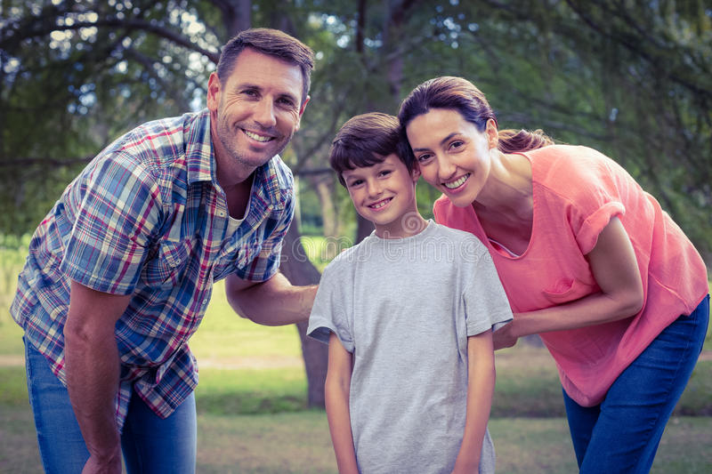 Happy family in the park together royalty free stock photo