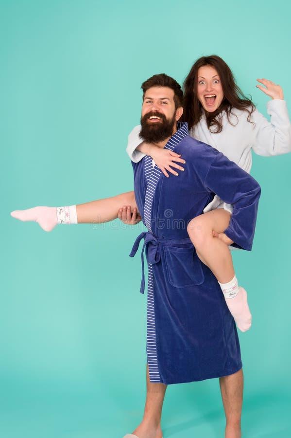 Happy family. Perfect morning. Having fun. woman and bearded man in robe. romantinc couple in love. man hipster love his. Happy family. Perfect morning. Having stock photos