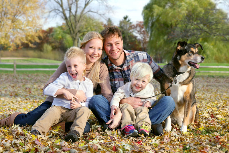 Happy Family and Pet Dog Autumn Portrait stock photo