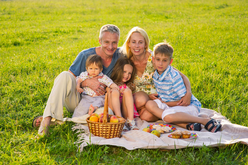 Happy family on a picnic. Parents with beautiful children royalty free stock photos