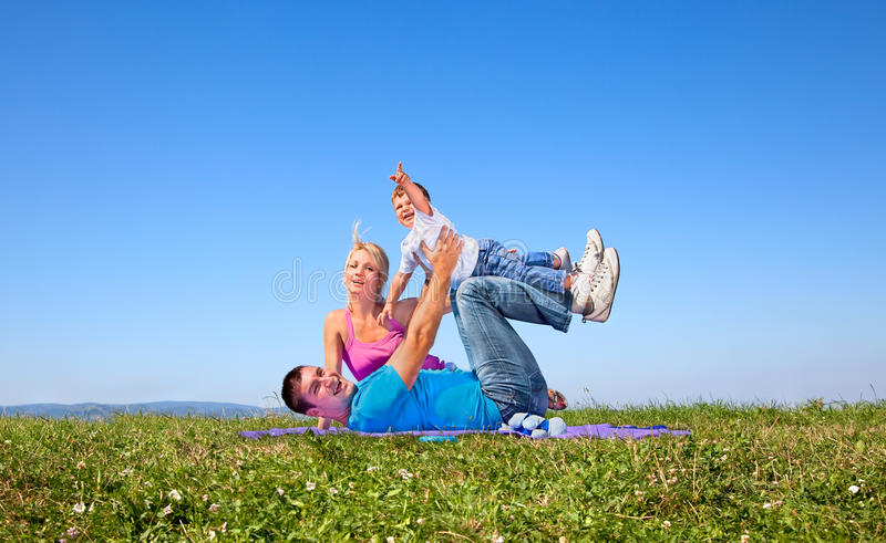 Happy family on picnic in park royalty free stock photography