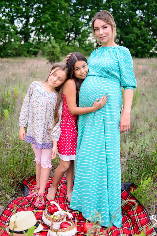 Happy family on picnic stock image