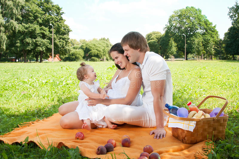Download Happy Family Picnicking In The Park Stock Photo - Image: 35625366