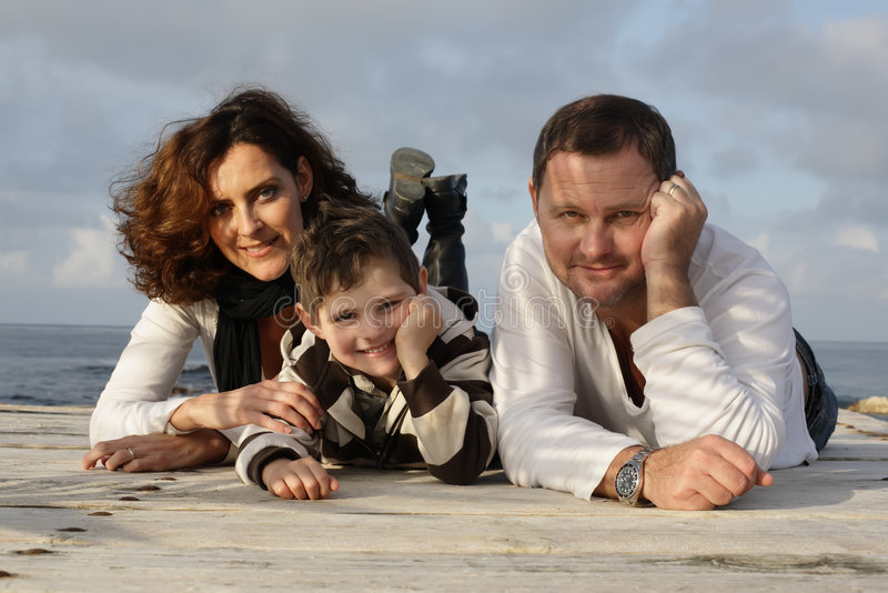 Happy family on a pier royalty free stock images