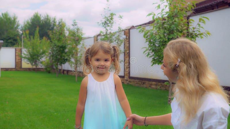 Happy family play at the backyard royalty free stock image