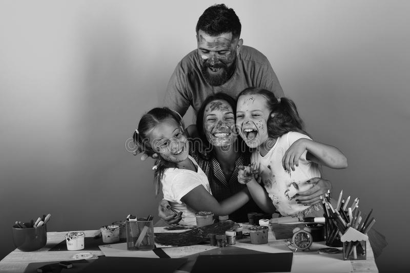 Happy family play. Family time and art concept. Artists create artwork and hug royalty free stock photos