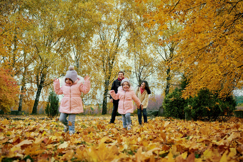 Happy family playing in autumn park stock photography
