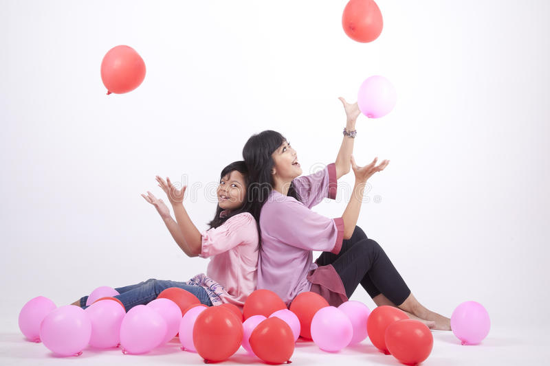 Download Happy Family Playing With Balloons Stock Image - Image: 21714025