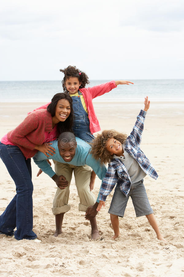 Happy family playing on beach royalty free stock photo