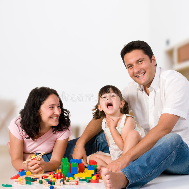 Happy family playing with blocks royalty free stock photo