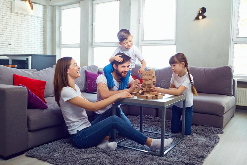 Happy family playing board games at home. stock image