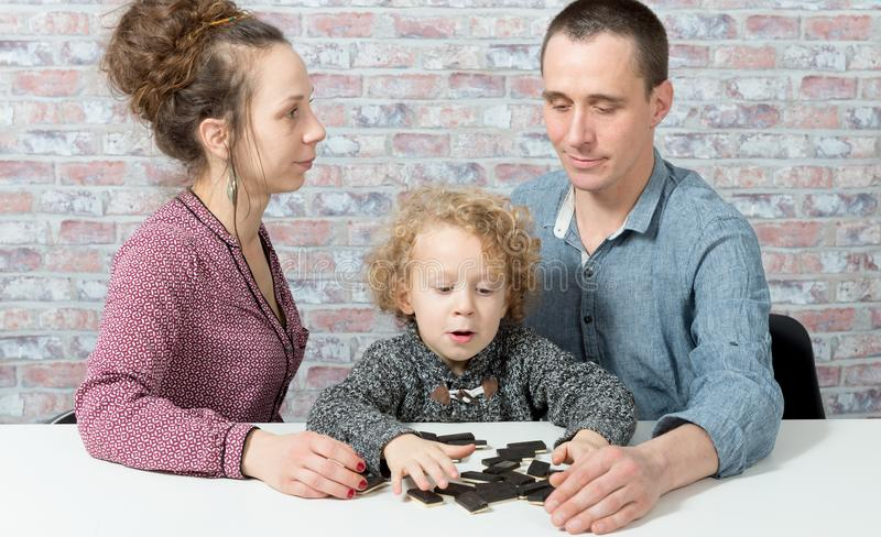 Happy family playing dominos stock photos