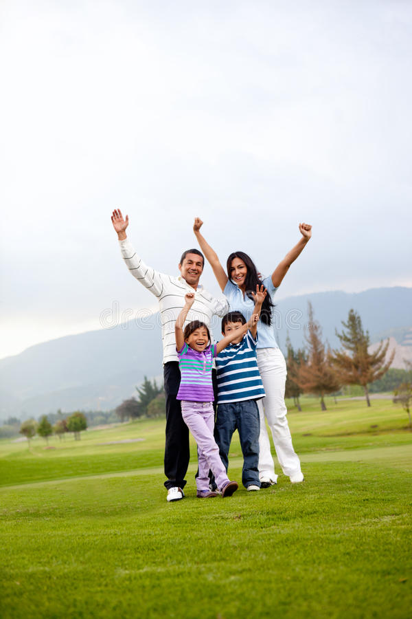 Happy family playing golf