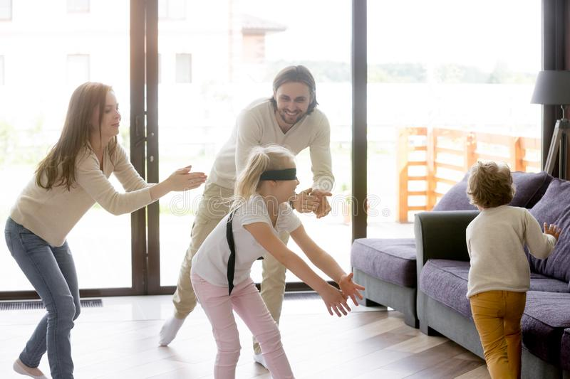 Happy family playing hide and seek at home royalty free stock image