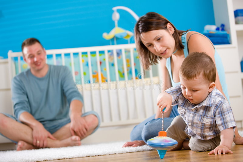 Happy family playing at home stock photography