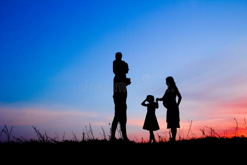 Happy family playing on nature summer silhouette royalty free stock image
