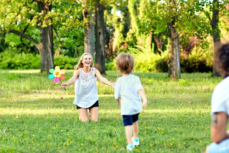 Happy family playing in the park. royalty free stock images