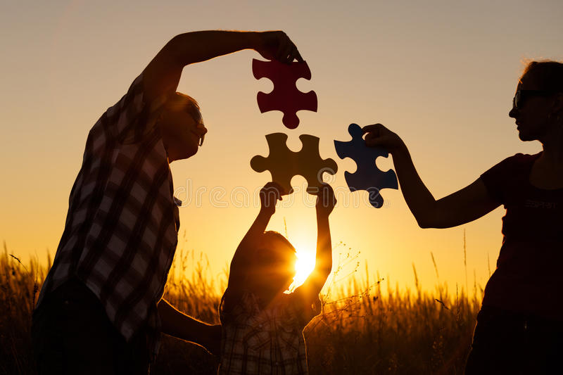 Happy family playing at the park at the sunset time. People having fun on the field. Concept of the kid is ready to go to school royalty free stock photos