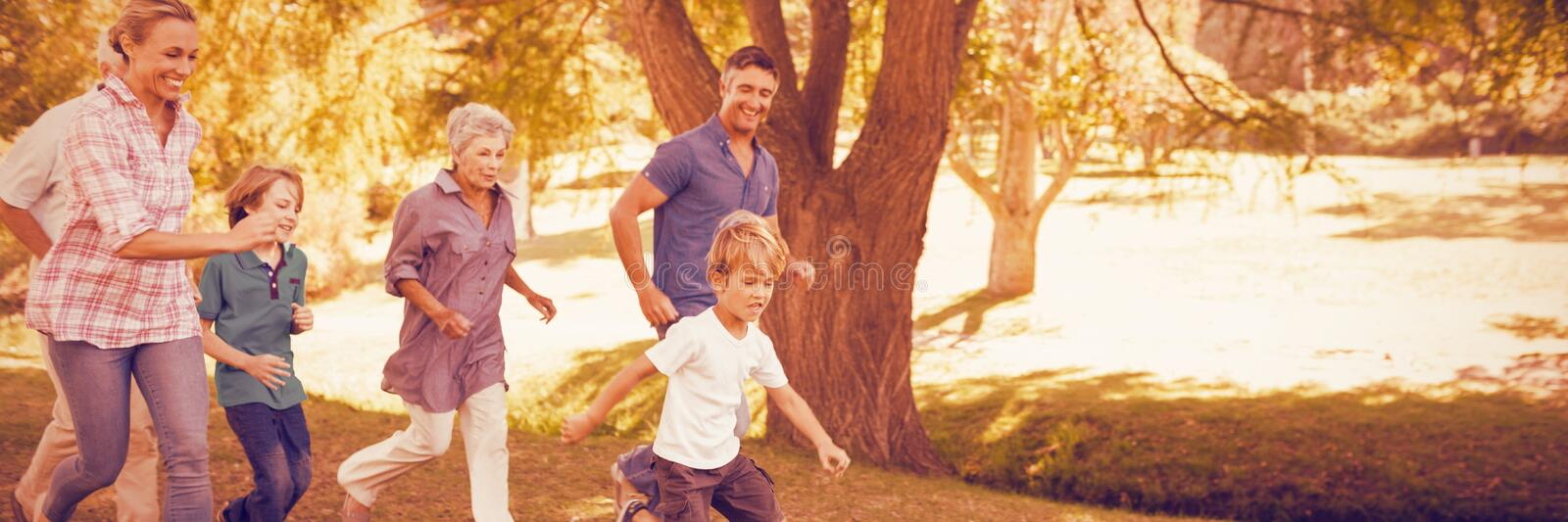 Happy family playing soccer stock image