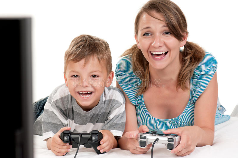 Happy family playing a video game royalty free stock photography