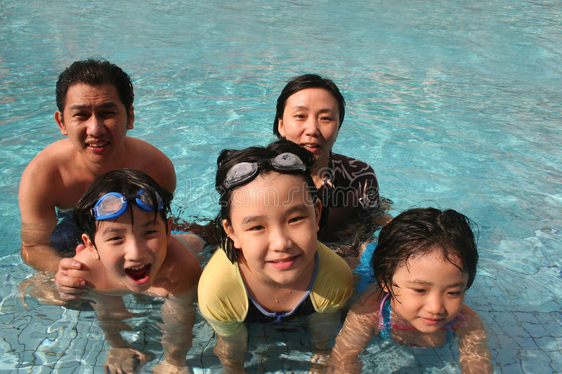 Happy Family In The Pool Stock Images