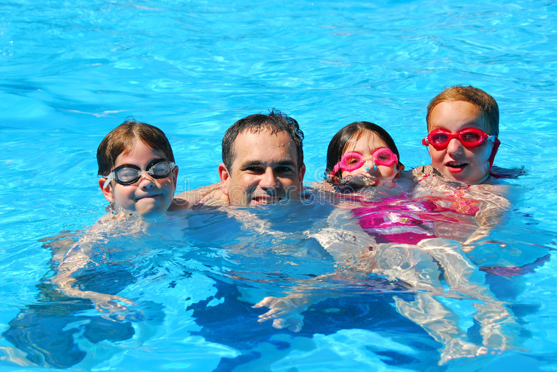 Happy family pool stock images image 979144 for Family holiday cottages with swimming pool